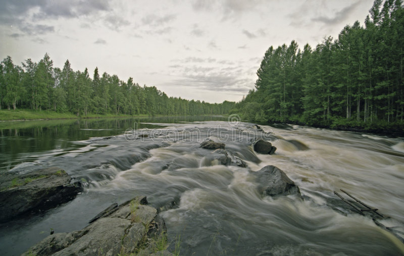 Water landscape with clouds, forest and rift royalty free stock photo
