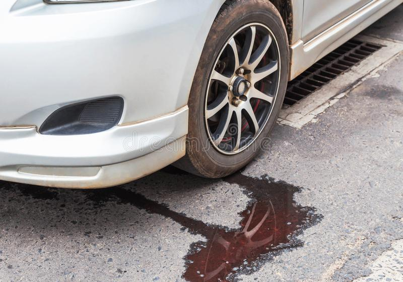Water leaking from car radiator. On the road royalty free stock image
