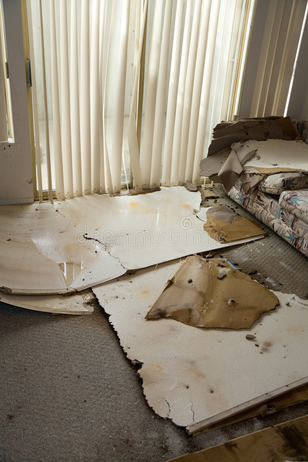 Water leaking damaged home. Home Interior Water leaking damaged plasterboard and carpet stock photo