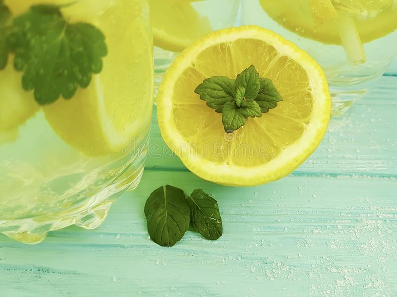 Water soda lemon citrus organic refreshment , freshness homemade health mint summer on a blue wooden background. Water lemon antioxidant mint blue wooden royalty free stock photography