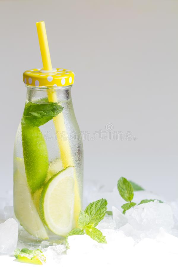 Water lemon and ice in the bottle fresh juice art food concept. Art royalty free stock image