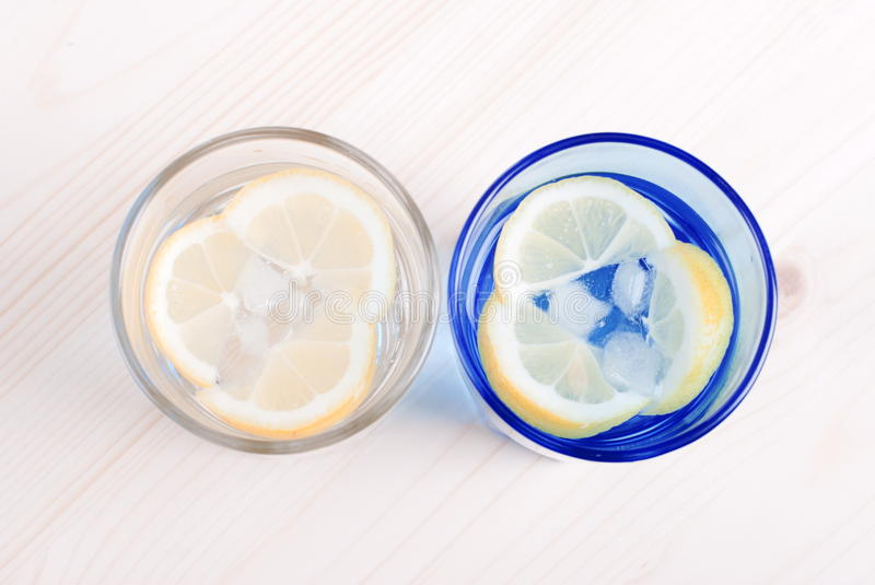 glass table top view. Download Water With Lemon And Mint In Blue Glass On The Table Top View Stock Image W