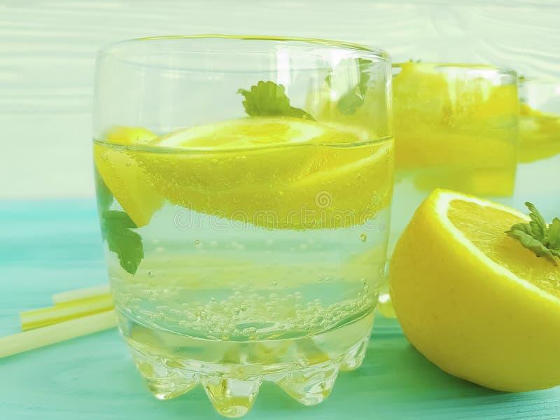 Water with lemon, mint fresh ingredient vitamin on a wooden background. Water with lemon mint on a wooden background vitamin fresh cold ingredient royalty free stock photos