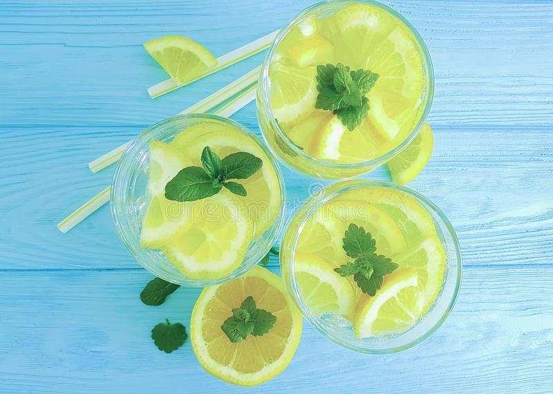 Water with lemon, mint on a wooden background. Water with lemon mint on a wooden backgroundn royalty free stock photo
