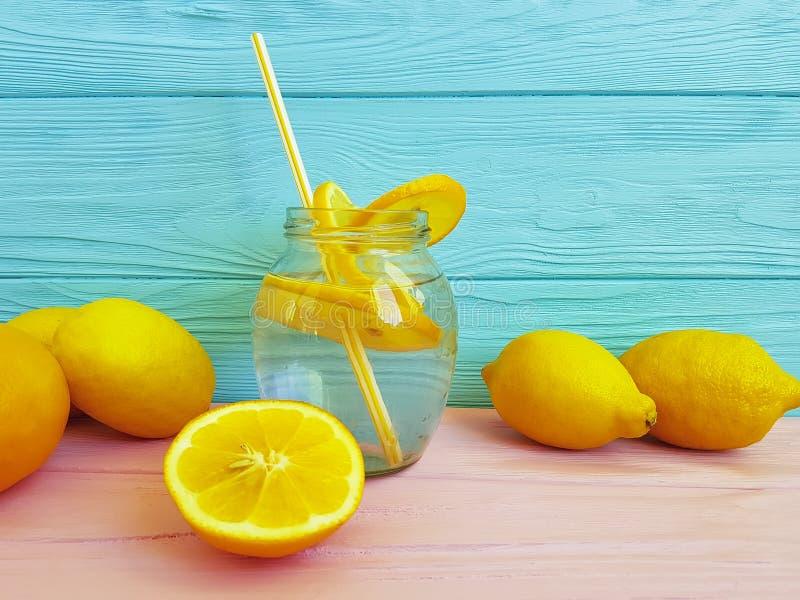 Water with lemon orange juice health a wooden. Water with lemon juice orange on a wooden health stock image