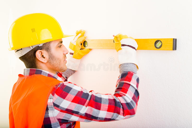 Water level. Construction worker using a water level royalty free stock photos