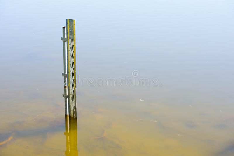 Water level gauge in river or dam water stock photography