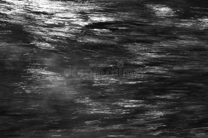 Water and light dark grey silver metal abstract background stock photography