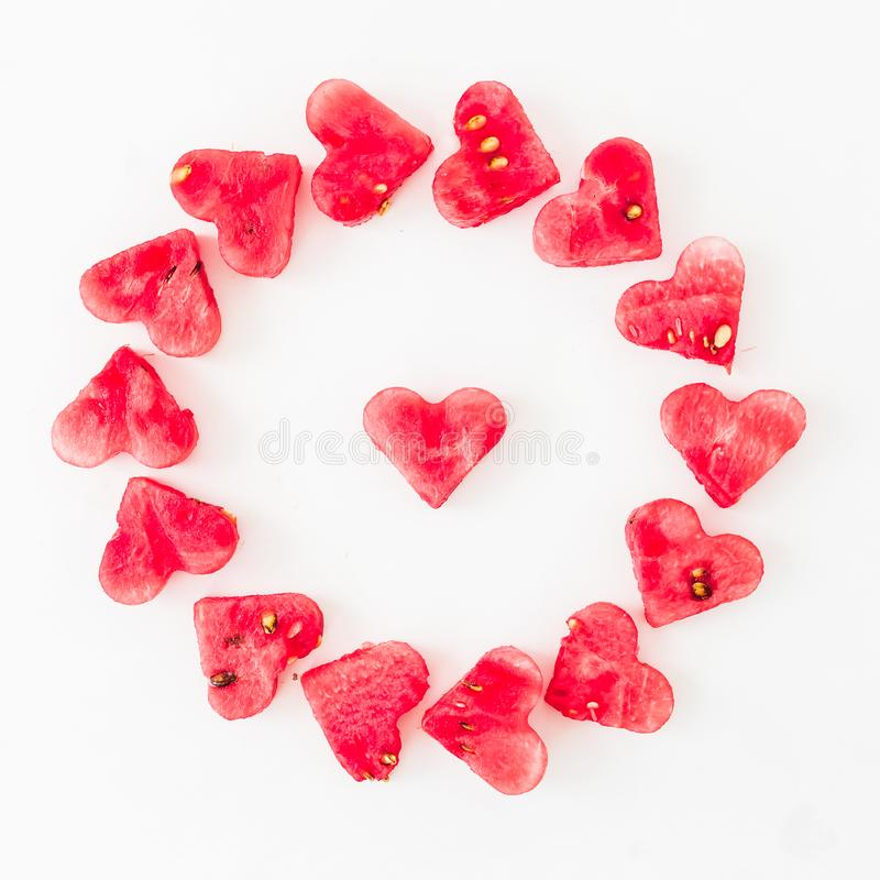 Water melon cut into heart shape on white background. Love concept. Valentine`s Day Concept. Flat lay, Top view stock photo