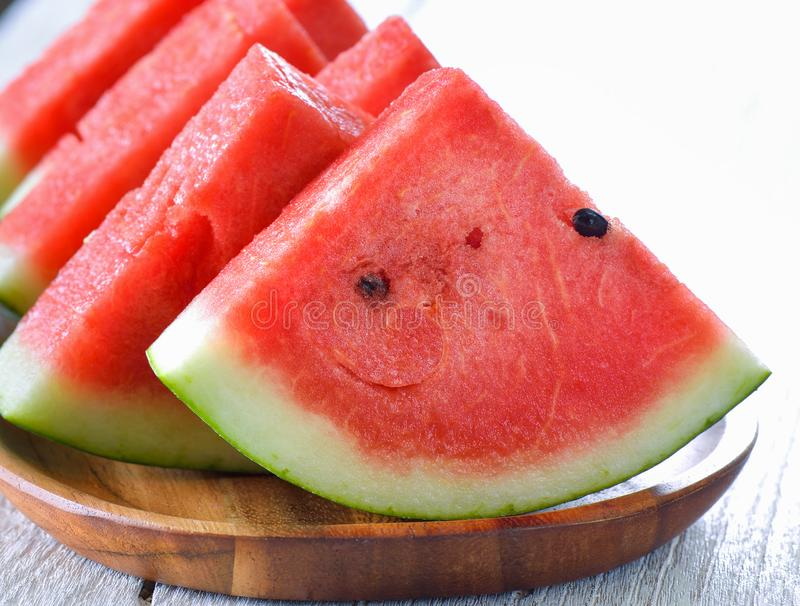 Water melon in wood plate on table stock images