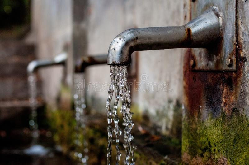 Water, Metal, Tree stock image