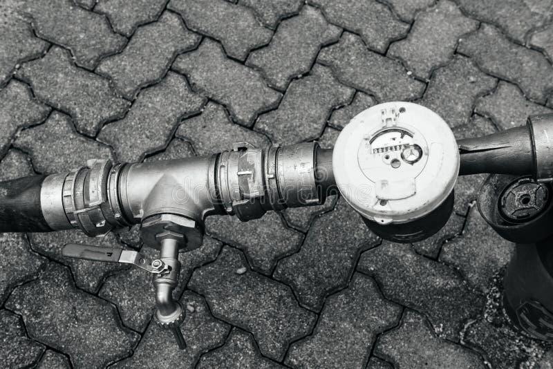 Water meter in city stock photos