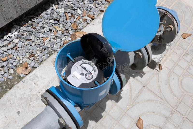 Water meter and metal pipes blue color for measurement of water flow. Water environmental conservation and water resource royalty free stock photography