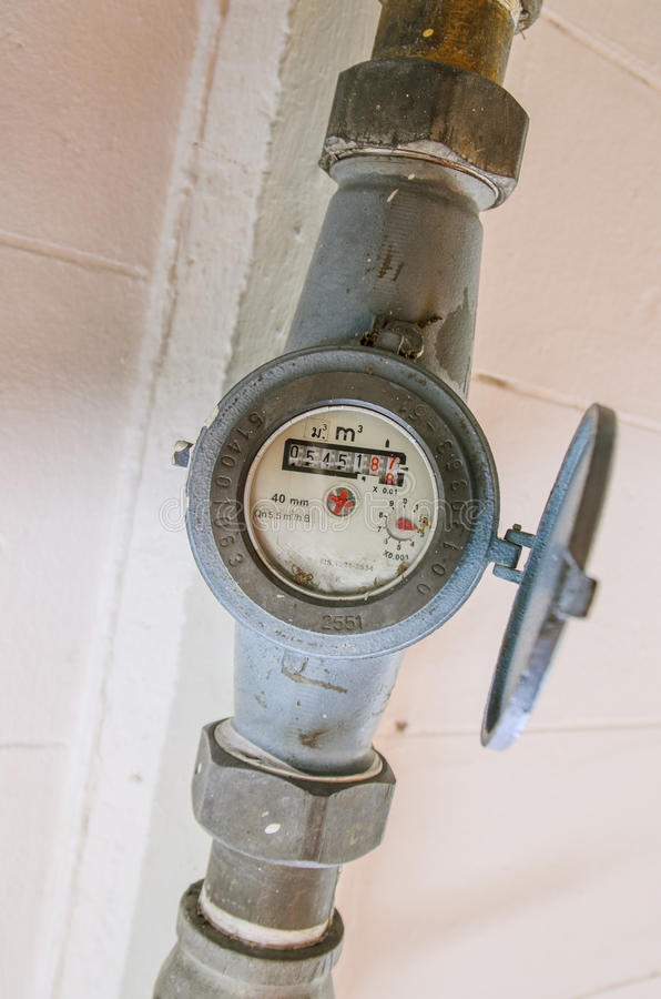Water Meter of white wall royalty free stock image