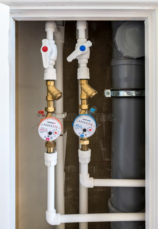 Water meters. Counters of hot and cold water stock images