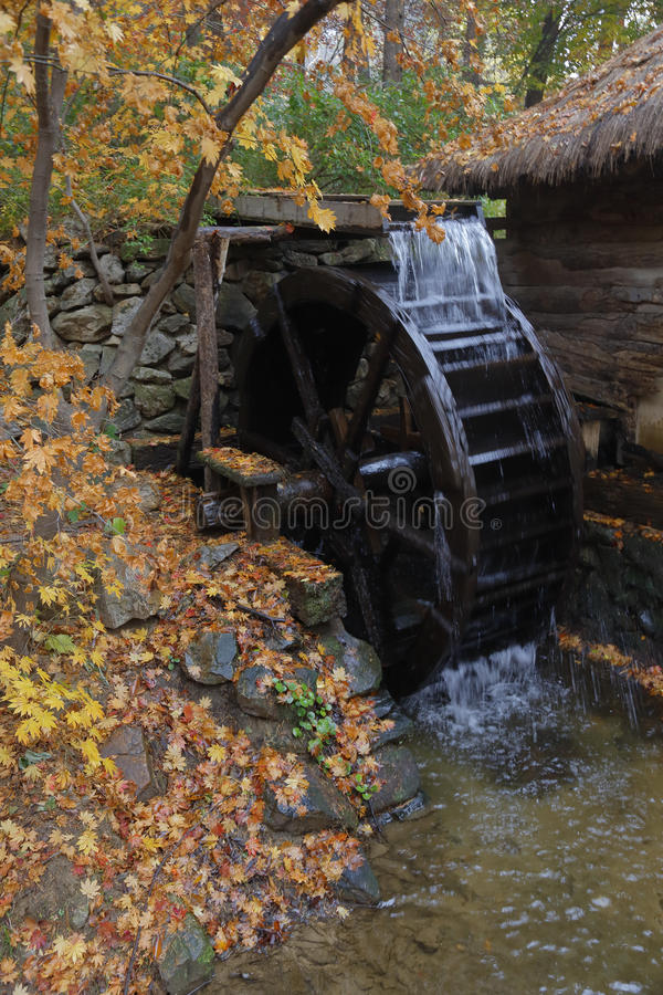 Water mill and Autumn color at Namsangol traditional folk village, Seoul, South Korea - NOVEMBER 2013 stock image