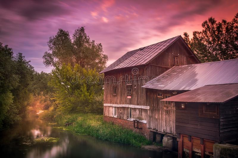 An old water mill in one of the villages in the Lublin region. Water mill - a building with a device for grinding grain into flour and groats, moved by means of royalty free stock photo