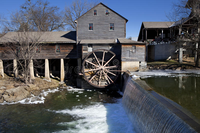 Water Mill in Pigeon Forge, Tennessee. Watermill on the Little Pigeon river, in the mountain community of Pigeon Forge, Tennessee during the winter. Ice can be royalty free stock images