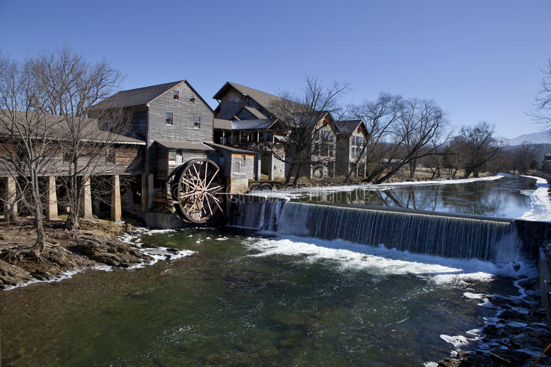 Water Mill in Pigeon Forge, Tennessee. Watermill on the Little Pigeon river, in the mountain community of Pigeon Forge, Tennessee during the winter. Ice can be royalty free stock photos
