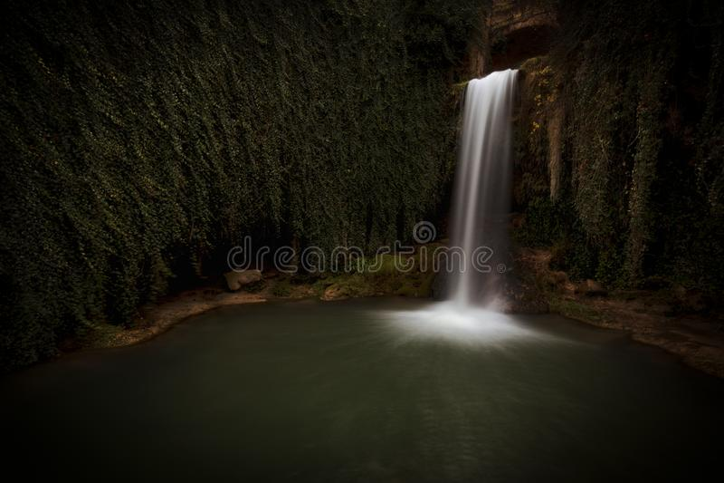 Water in motion at Tobera waterfall stock photo