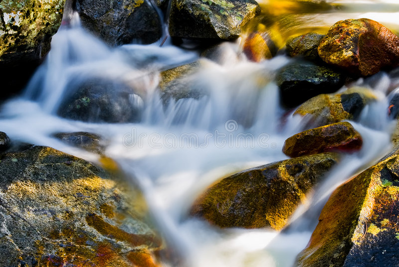 Water movement on the rocks royalty free stock photos