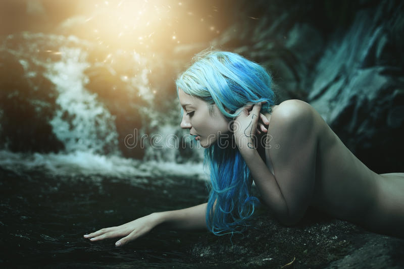 Water nymph and magical lights stock images