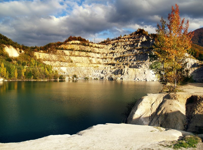Water in open quarry. Water or pond in an abandoned open quarry or mine royalty free stock images