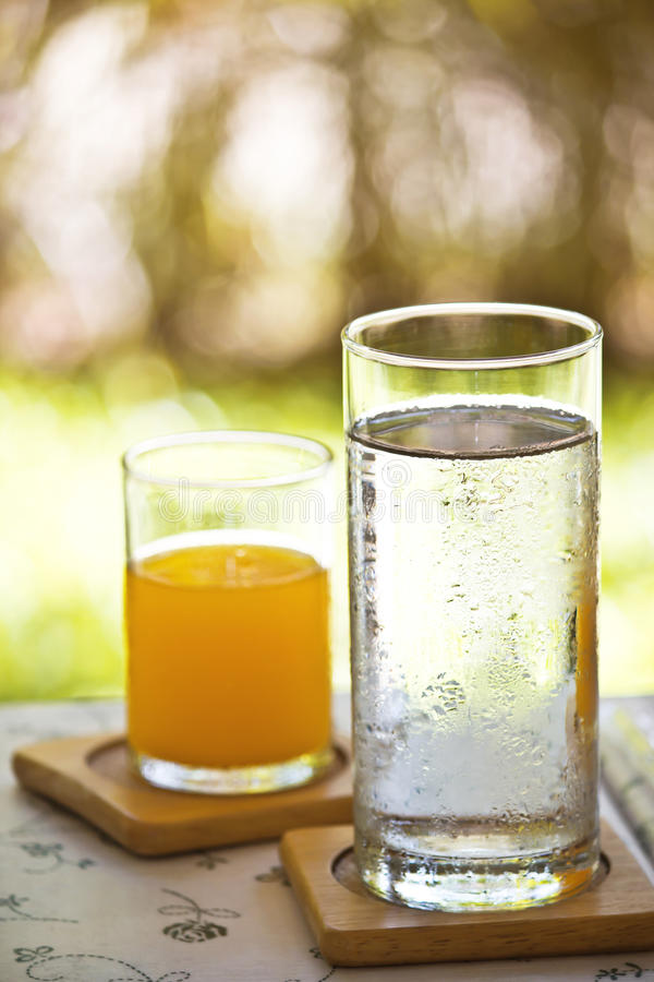 Water and orange juice stock photography