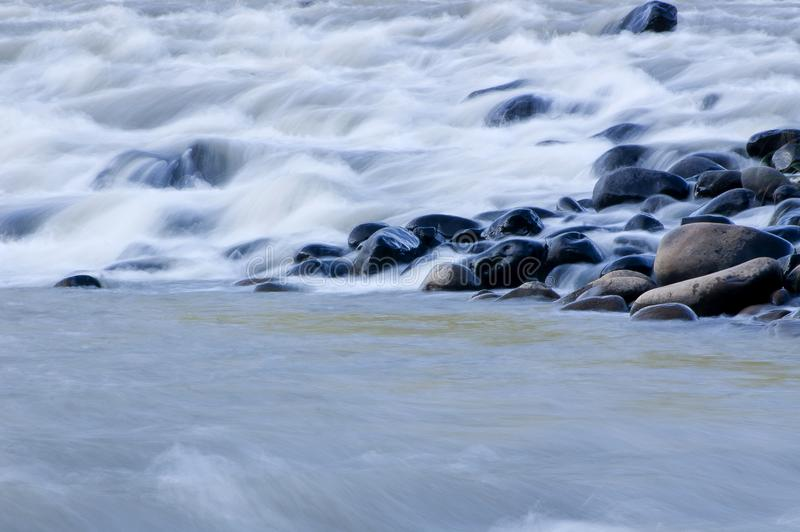 Moving water, slow motion,. Water over rocks on a rapid, slow shutterspeed, Umkomaas river, Kwazulu natal, south africa royalty free stock photography