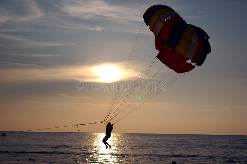 Water parachuting. Silhoutte of Parachuting by the sea royalty free stock photography