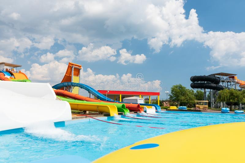 Water Park slide with pool and beautiful blue sky, no people.  royalty free stock photo