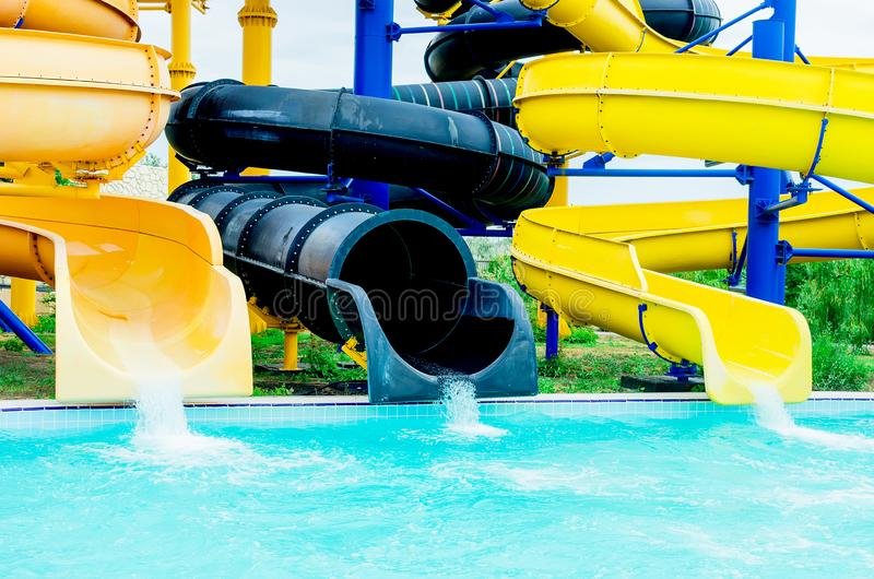 Water park slides. sunny summer day. Colorful waterpark tubes and pool in aquapark. Water park slides close up. sunny summer day stock images