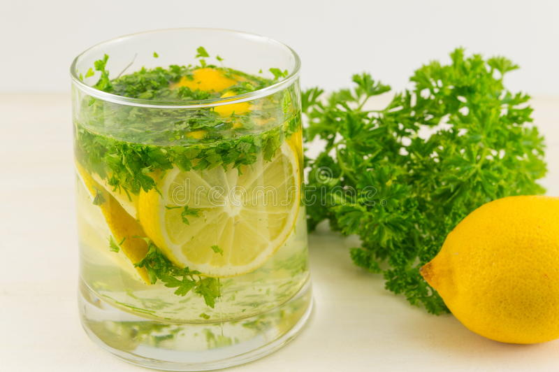 Water with parsley and lemon. Diet beverage stock photography