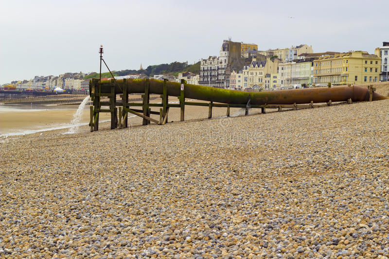 Water pipe on the beach. A rusty water pipe on the beach of Hastings royalty free stock images