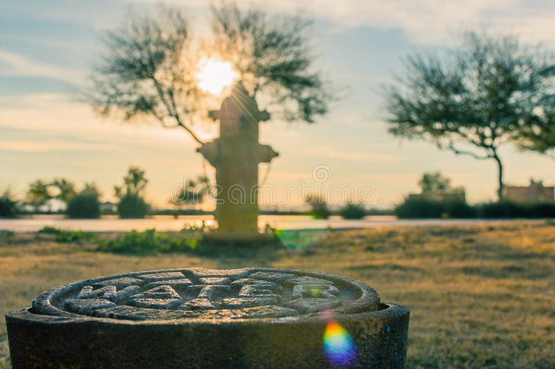 Water pipe in front of a hydrant stock photography