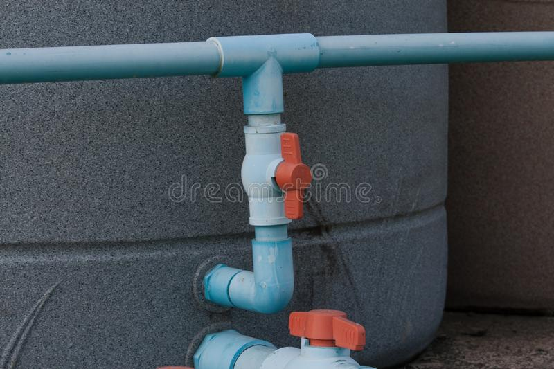 Water pipe with red valve and tank royalty free stock photography