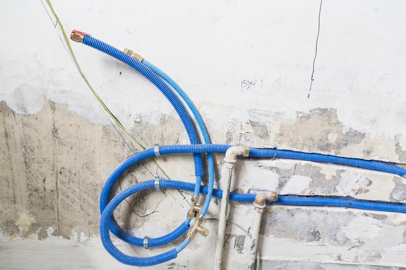 Water pipes made of polypropylene PEX in the wall, plumbing in the house. Installation of sewer pipes in a bathroom of an apartmen. T interior during renovation royalty free stock image