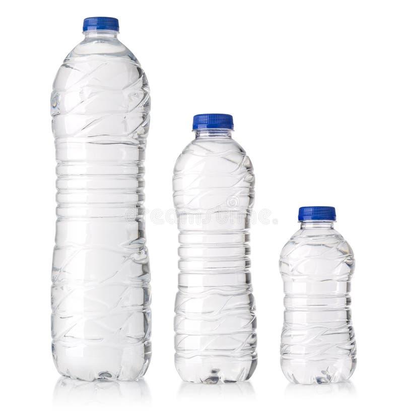 Water plastic flessen stock foto's