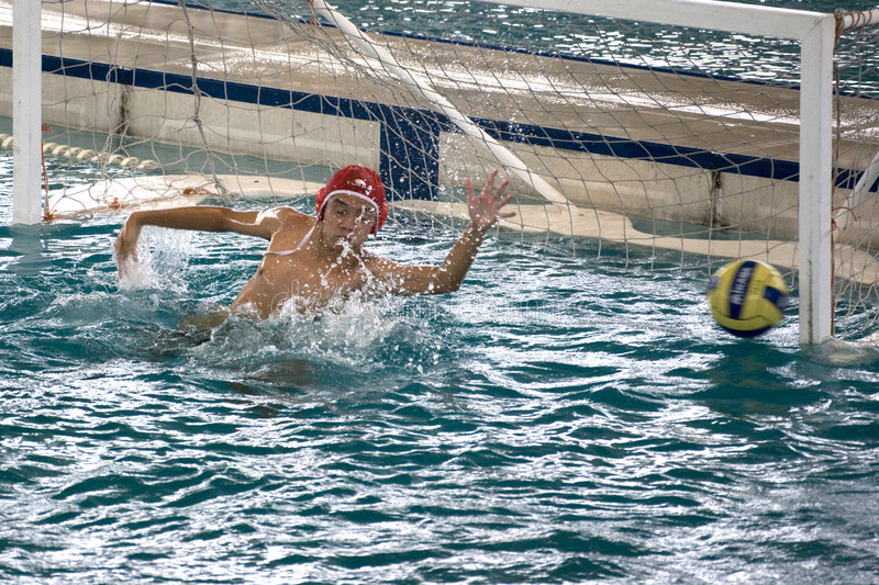 Water Polo Action. Men's water polo action between the Malaysian states of Penang and Perak at the Malaysian Open Water Polo Championships Games held at PISA stock photo