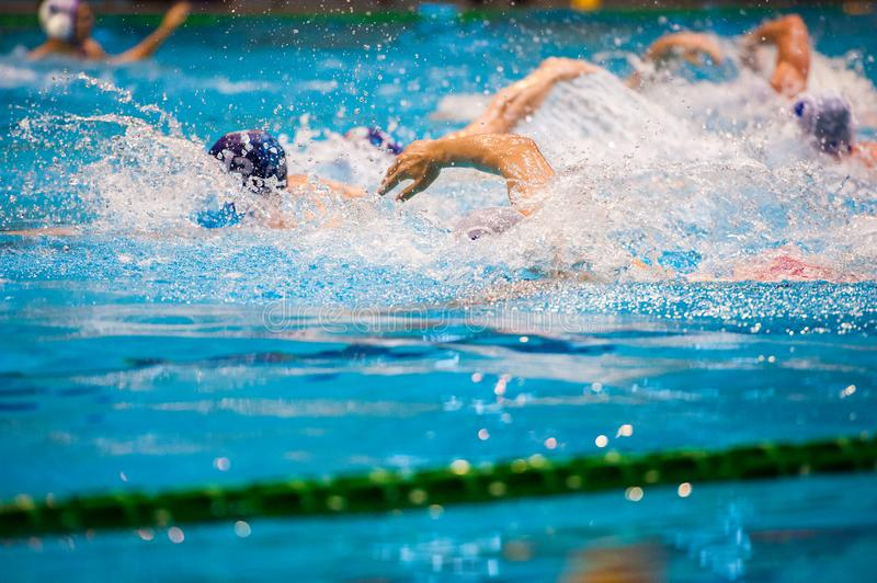 Water polo players. Water polo action in a swimming pool stock images