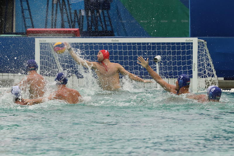 Water Polo Team Greece in white scores during Rio 2016 Olympics Men`s Preliminary Round Group A match against Team Hungary. RIO DE JANEIRO, BRAZIL - AUGUST 10 stock image