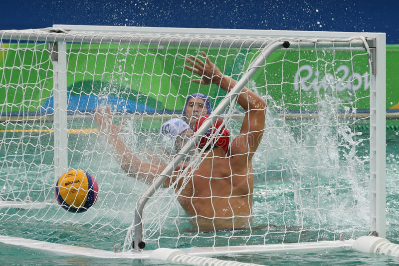 Water Polo Team Hungary in blue scores during Rio Olympics Men`s Preliminary Round Group A match against Team Greece. RIO DE JANEIRO, BRAZIL - AUGUST 10, 2016 royalty free stock photo
