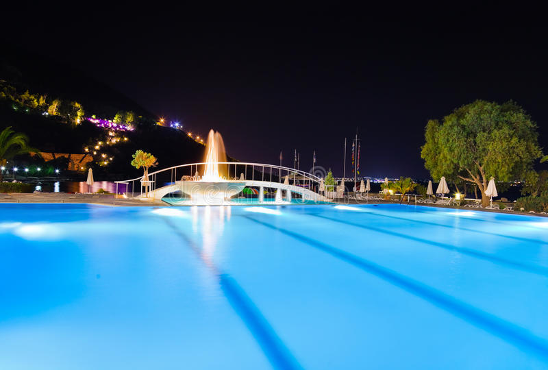 Download Water Pool And Fountain At Night Stock Photo - Image of light, chair: 22325582