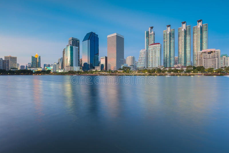 Water pool at Public Park with office building. Before sunset with water reflection, Bangkok Thailand stock photography