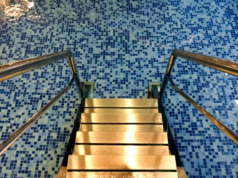 Water pool stairs indoors. Indoor water pool stairs.Mosaics stock images