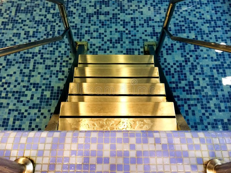 Water pool stairs indoors. Indoor water pool stairs.Mosaics stock photography