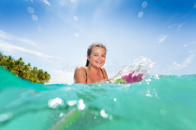In the water portrait of a girl on surfboard stock images