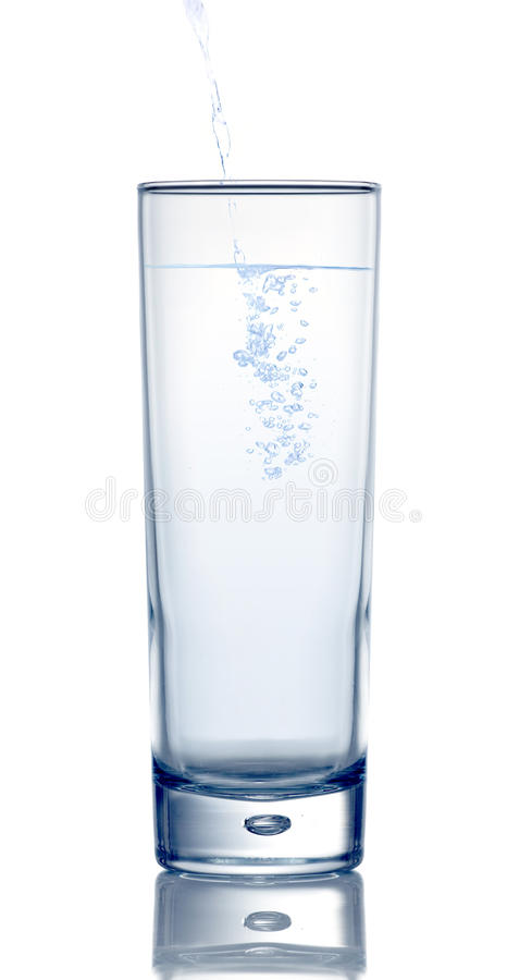 Water pouring into glass royalty free stock photos