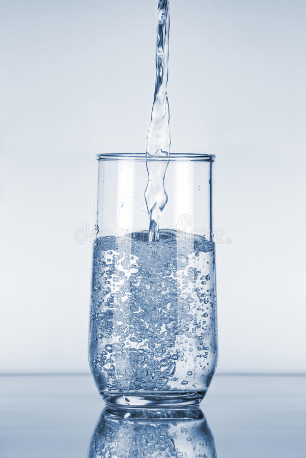 Water Pouring in Glass stock images