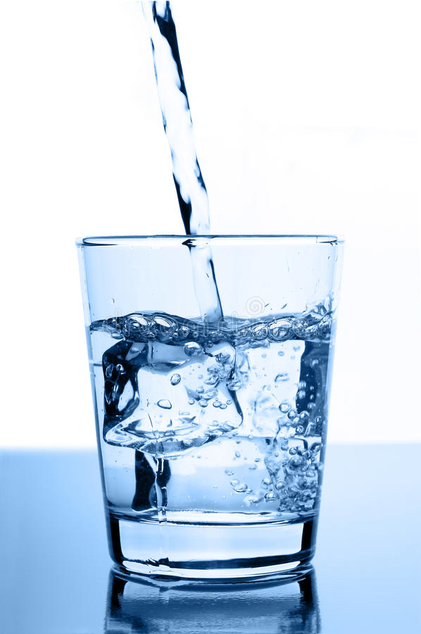 Free Water Pouring In To Glass With Ice Cubes Stock Photography - 23729222